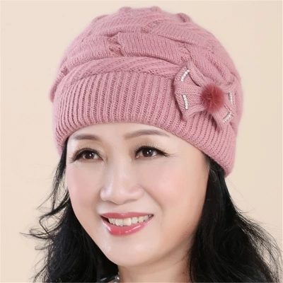 ecc53cb97de Wishlist (0 favorites). The old woman in the warm winter hat old lady  rabbit hair knitted ...